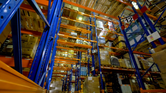 Big indutrial warehouse interior. Storage facility with no people. 4K. video