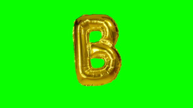 Big Letter B from alphabet helium gold balloon floating on green screen Big Letter B from alphabet helium gold balloon floating on green screen alphabet stock videos & royalty-free footage
