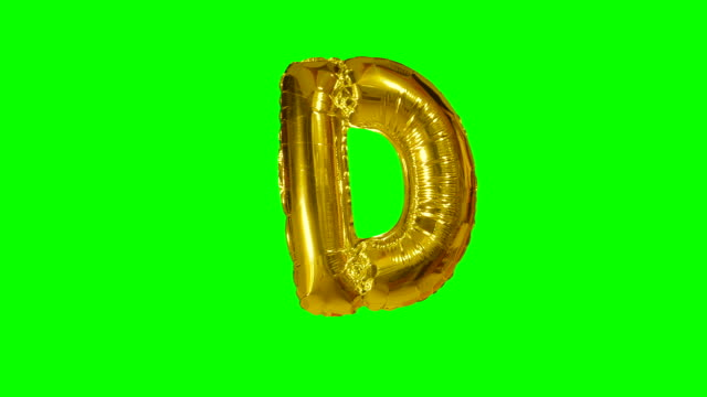 Big Letter D from alphabet helium gold balloon floating on green screen Big Letter D from alphabet helium gold balloon floating on green screen alphabet stock videos & royalty-free footage