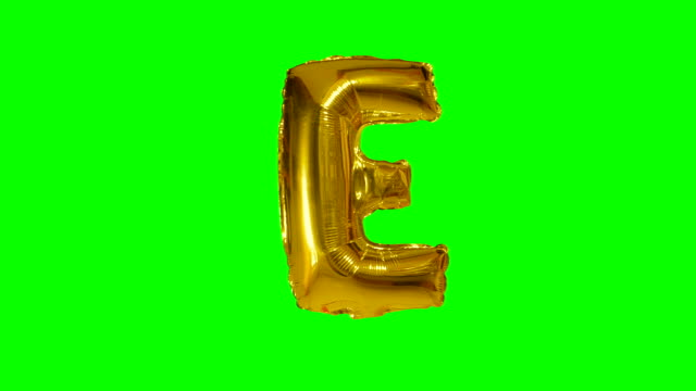 Big Letter E from alphabet helium gold balloon floating on green screen Big Letter E from alphabet helium gold balloon floating on green screen alphabet stock videos & royalty-free footage