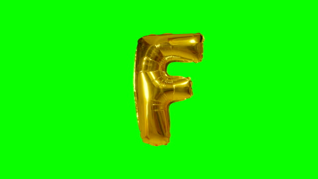 Big Letter F from alphabet helium gold balloon floating on green screen