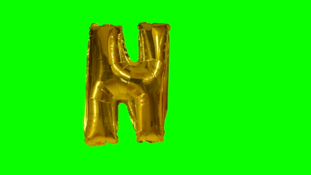 Big Letter N from alphabet helium gold balloon floating on green screen Big Letter N from alphabet helium gold balloon floating on green screen alphabet stock videos & royalty-free footage