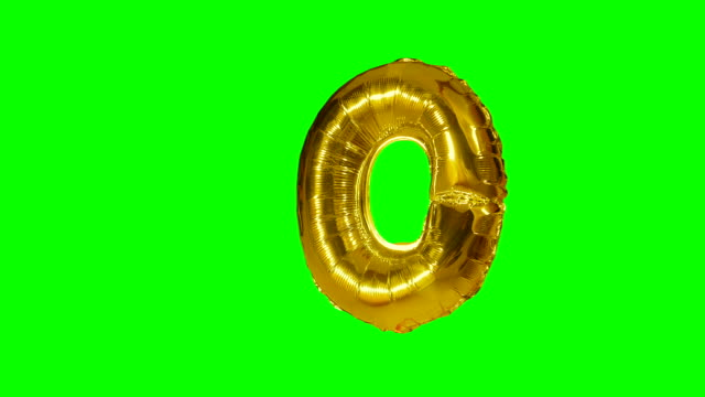 big letter o from alphabet helium gold balloon floating on green screen - wielka litera filmów i materiałów b-roll