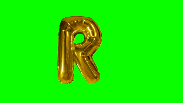 Big Letter R from alphabet helium gold balloon floating on green screen Big Letter R from alphabet helium gold balloon floating on green screen alphabet stock videos & royalty-free footage