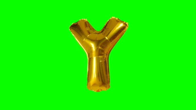 Big Letter Y from alphabet helium gold balloon floating on green screen Big Letter Y from alphabet helium gold balloon floating on green screen alphabet stock videos & royalty-free footage