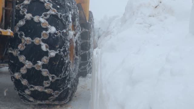 A big machine clears snow from the road A big machine clears snow from the road construction equipment stock videos & royalty-free footage