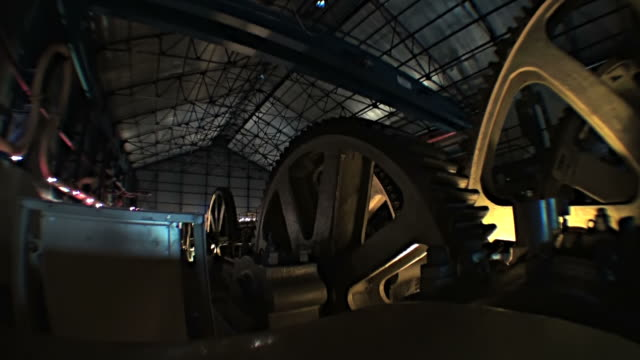Big mechanism with huge spinning gears of old sugar refinery video