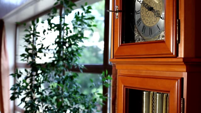 Big old wooden clock with pendulum, Old wooden clock with a pendulum, antique wooden clock with a pendulum