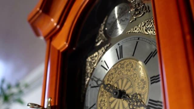 Big old wooden clock with pendulum, Old wooden clock with a pendulum, antique wooden clock with a pendulum