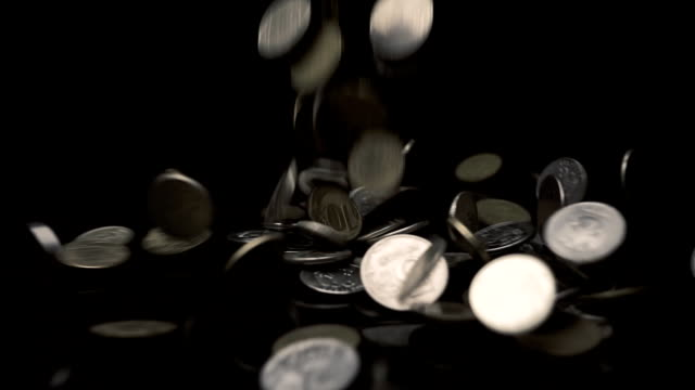 Big pile of coins fall on the table and flying away in different directions Big pile of coins fall on the table and flying away in different directions. Slow motion, high speed camera, 250fps us coin stock videos & royalty-free footage
