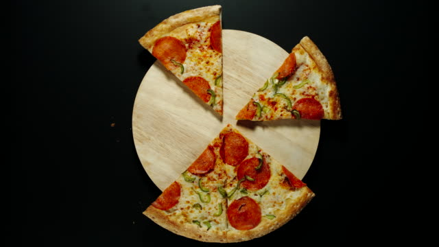 RANDOM: Big Pizza Is Eaten Up On The Wooden Board, Black Background