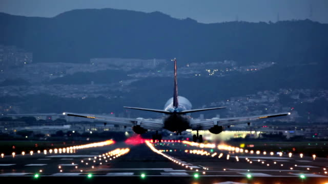 big plane landing during the blue hour video