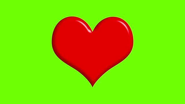 緑色の画面上で脈動する大きな赤い心臓 - アイコン プレゼント点の映像素材/bロール