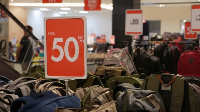Big red sale sign at a shopping mall. 50 percent off clearance sale. Promotion. Consumerism concept. Discount concept. 4k