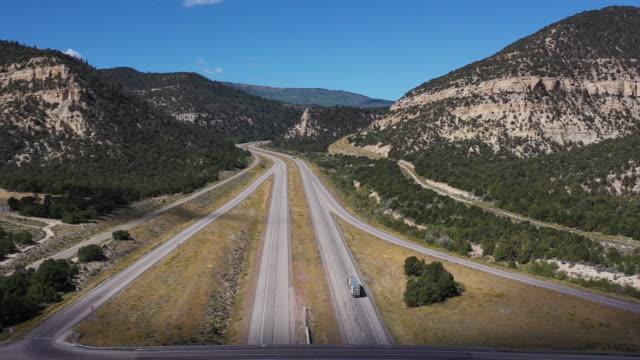 Big Rig Truck Driving on Utah Freeway Aerial Drone Nature Big Rig Truck Driving on Utah Freeway Aerial Drone Nature towing stock videos & royalty-free footage