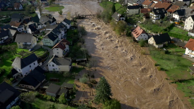 AERIAL: Big river flooding the suburbs after heavy rain video