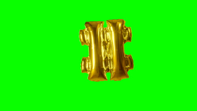big sign symbol number hash pound from alphabet helium gold balloon floating on green screen - wielka litera filmów i materiałów b-roll