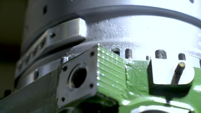big silver - green metal parts. - lega metallica video stock e b–roll