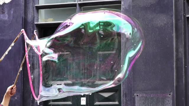 Big soap bubble being made and floating in the air then explode in slow motion 120 fps Big soap bubble being made and floating in the air then explode in slow motion 120 fps giant fictional character stock videos & royalty-free footage