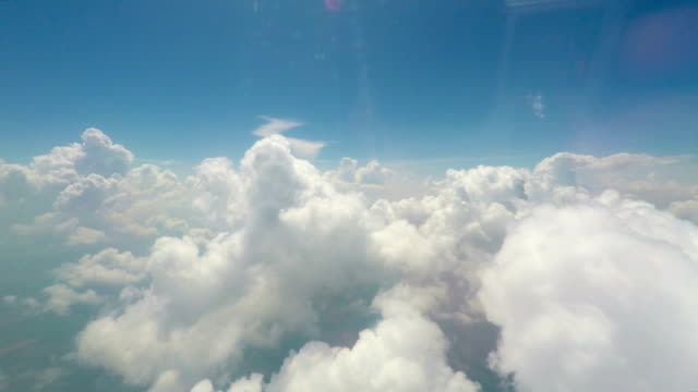 Big soft clouds floating in sky, interminable vast space, view from flying plane Big soft clouds floating in sky, interminable vast space, view from flying plane heaven stock videos & royalty-free footage