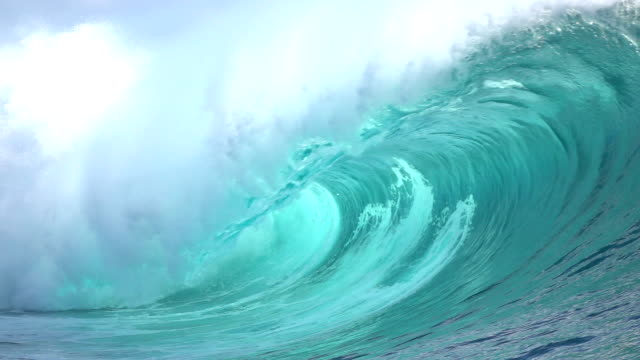 SLOW MOTION CLOSE UP: Big Teahopoo wave breaking and splashing SLOW MOTION CLOSE UP: Big powerful Teahupoo tube wave breaking and splashing over the island reef, water drops spraying in the wind in sunny summer breaking stock videos & royalty-free footage