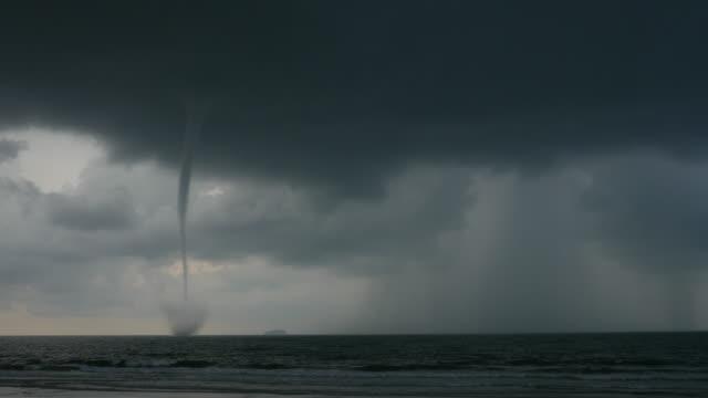 big tornado at the sea on a cloudy day - tornado video stock e b–roll