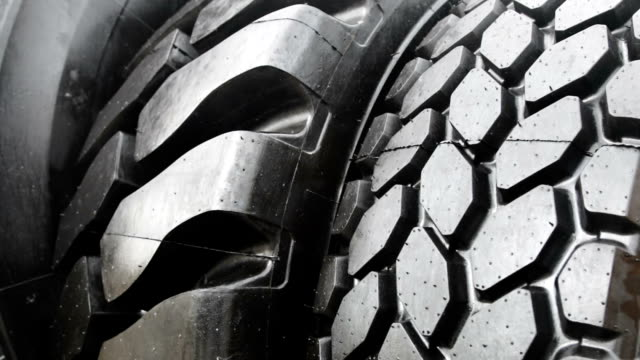stora däck av en traktor eller bulldozer - wheel black background bildbanksvideor och videomaterial från bakom kulisserna