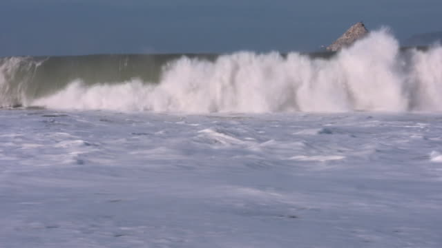 Big waves breaking on the shore HD video