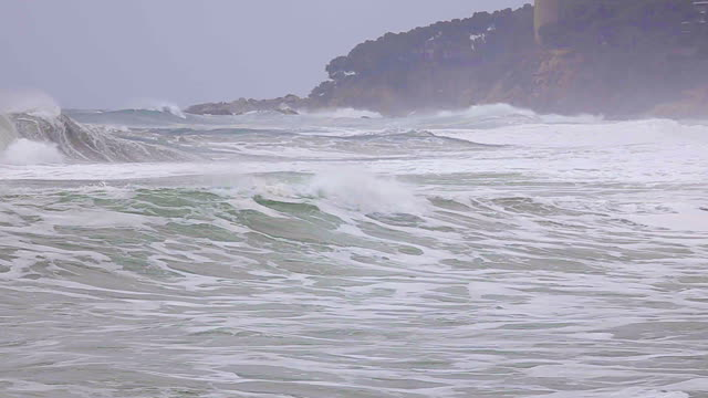 big waves in a spanish coastal at springtime in costa brava, near the town palamos, slow motion footage - mar mediterraneo video stock e b–roll