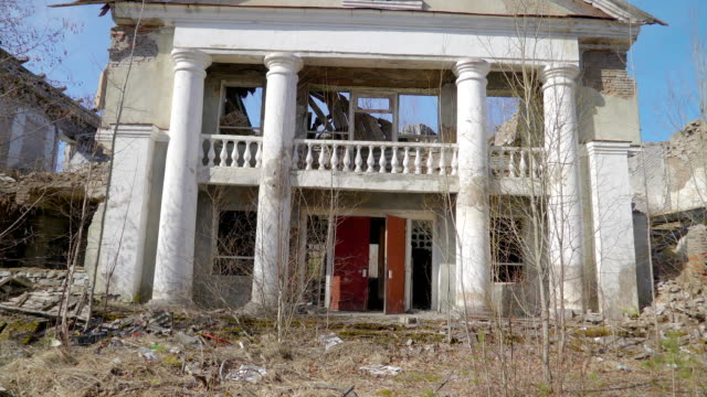 A big white house ruined from the war in ukraine video