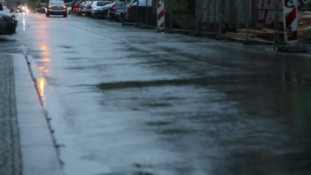 Bike and car on wet asphalt video