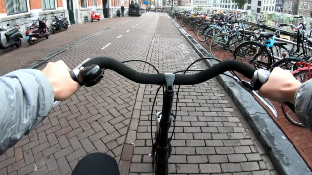 bike cycling at amsterdam netherlands - dutch architecture stock videos & royalty-free footage