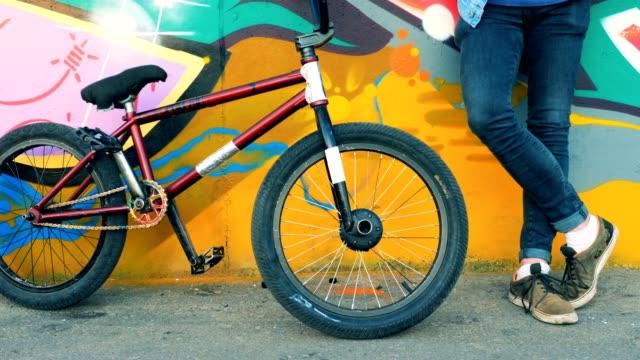 BMX bike falls on the ground in a skatepark. 4K.