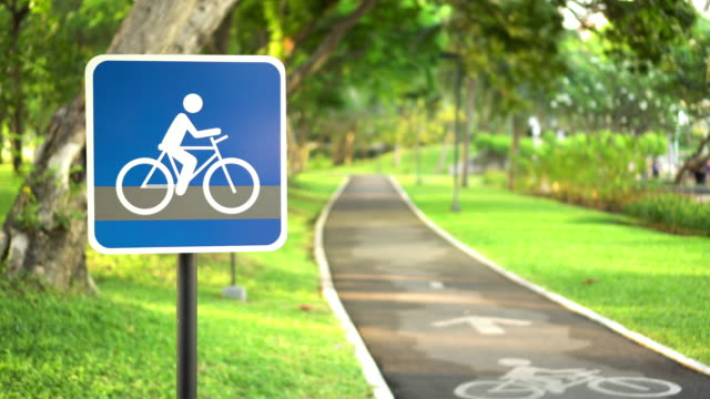 Bike lane in public park Bike lane in public park,Video 4k. natural parkland stock videos & royalty-free footage