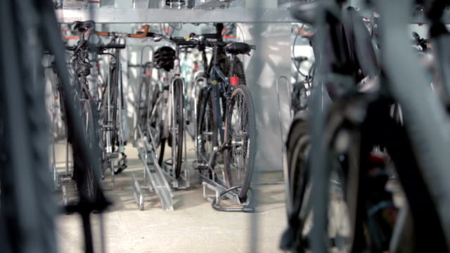 Bike Push Bike being pushed through studio. storage room stock videos & royalty-free footage