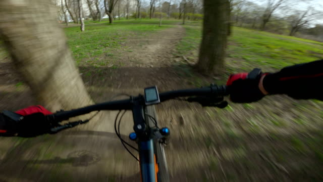 bike riding speed bike riding in early spring park handlebar stock videos & royalty-free footage