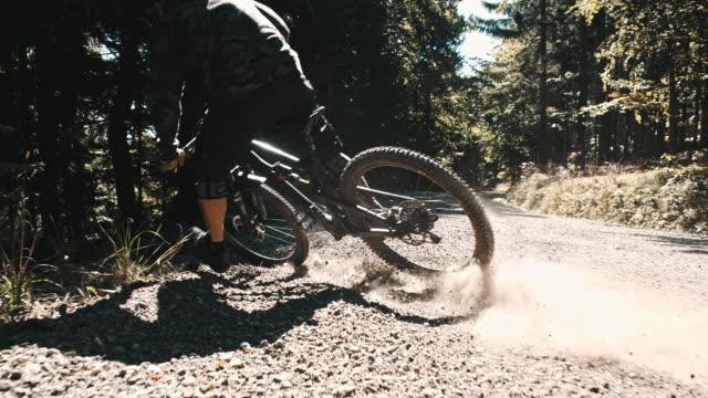 SLO MO MTB biker carving through turn video