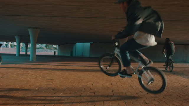 BMX biker driving around on a urban place video