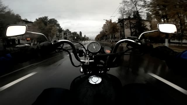 Biker motorcycle chopper rides on the wet asphalt in the city Biker motorcycle chopper rides on the wet asphalt in the city Full HD handlebar stock videos & royalty-free footage