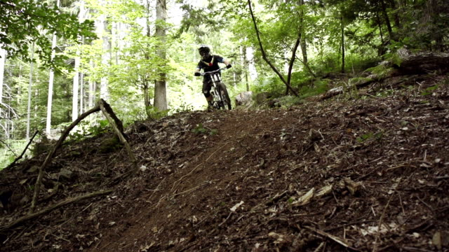 SLOW MOTION: Biker riding down the steep slope video