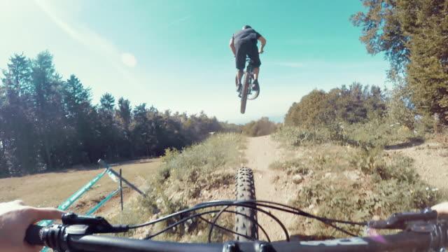 POV Bikers riding on a downhill trail video
