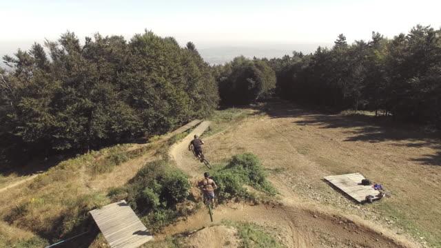 AERIAL MTB bikers riding on a downhill trail video