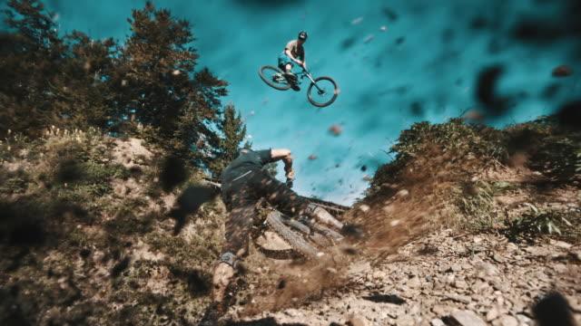 SLO MO Bikers speeding on a downhill trail video
