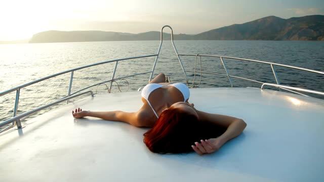 Bikini Female Sunbathing on Luxury Yacht video