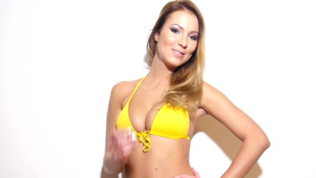 Bikini fitness girl on white background - fun positive slow dance video