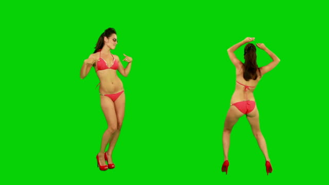 stockvideo's en b-roll-footage met bikini girl dancing. green screen - green background