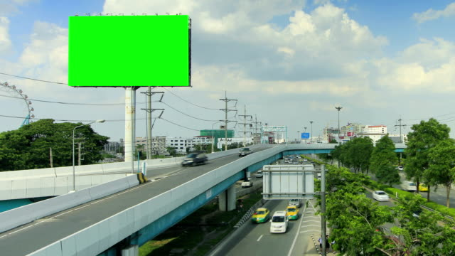 Billboard and highway with moving cloud ,time lapse video