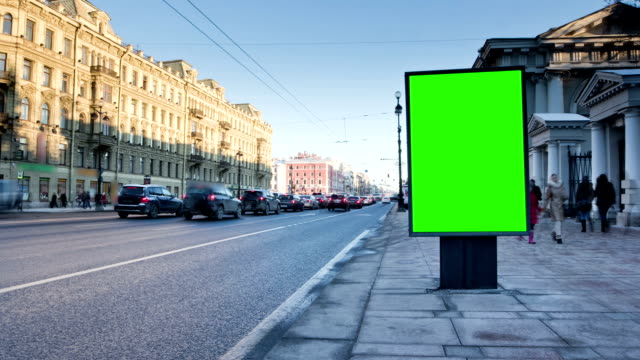 Billboard chromakey on the city street. timelapse video