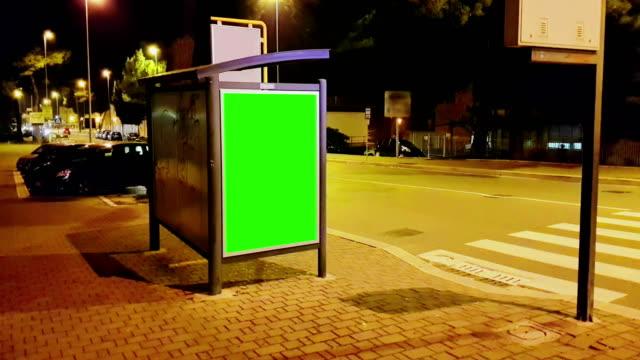 billboard with a chroma key green screen on a traffic cars city night street, light night, advertisement - poster стоковые видео и кадры b-roll