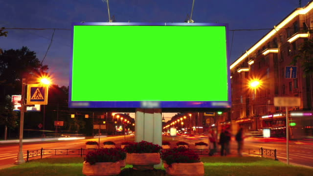 a billboard with a green screen on a busy street - road signs stock videos and b-roll footage